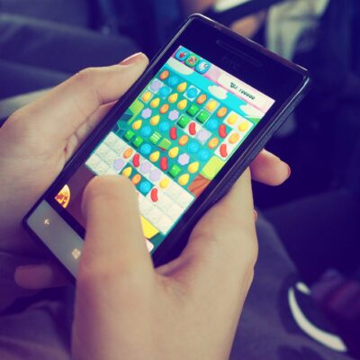 person playing candy crush on nokia smartphone